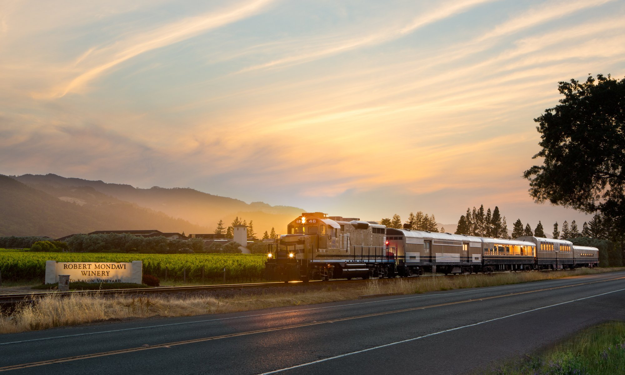 Napa Valley Wine Train pulling up to Robert Mondavi Winery at sunset