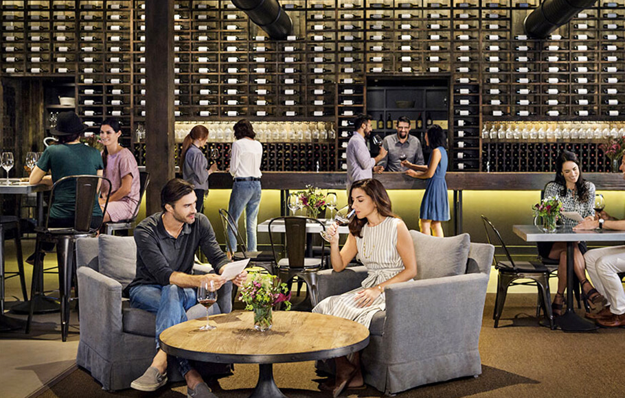 five couples sitting and standing in the bar area of a Napa Valley winery