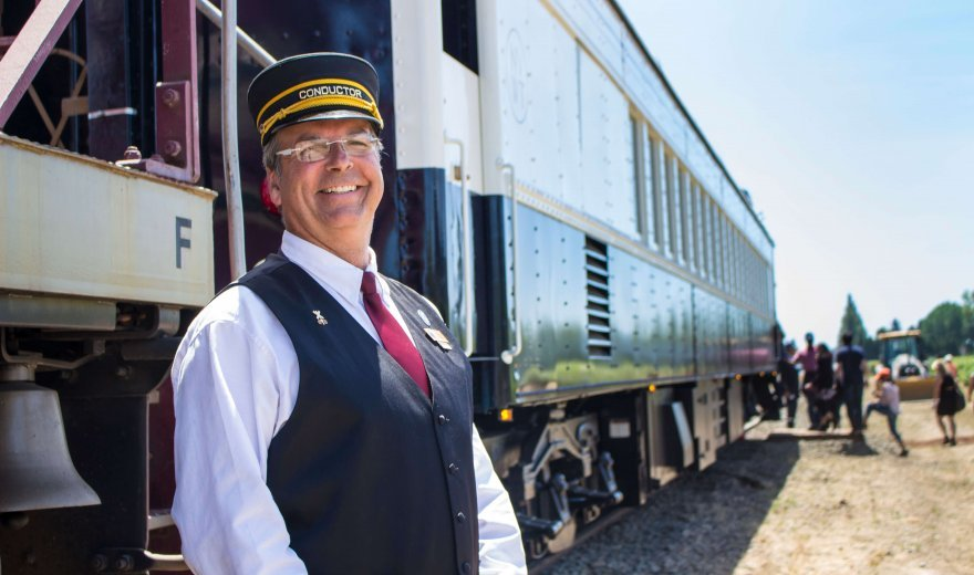 conductor of Napa Valley Wine Train standing outside the train
