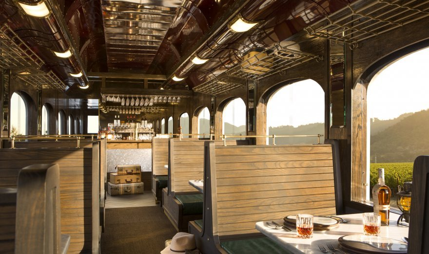 Inside of the 1013 train - vintage style wooden benches with tables