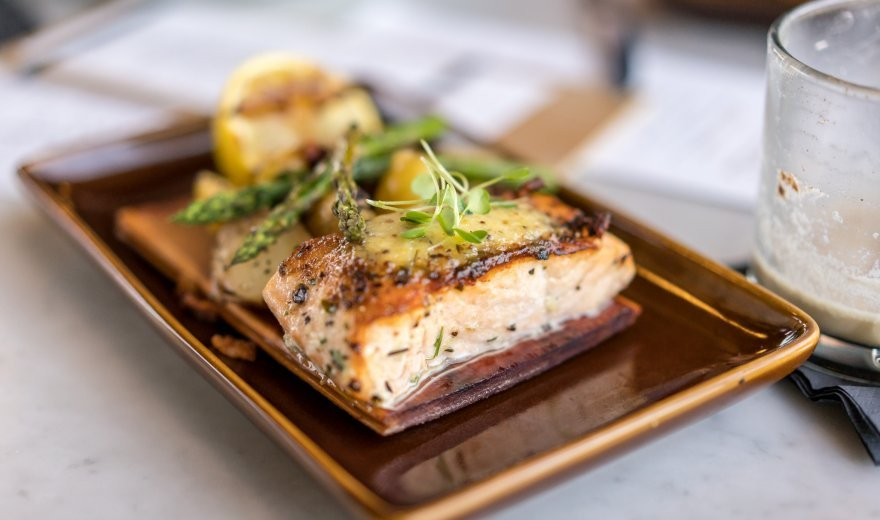 Cracked mustard-cider glazed salmon on a brown rectangle plate