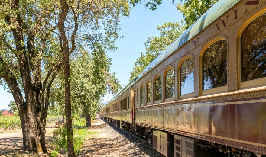 Napa Valley Wine Train stopped along the tracks on a sunny day