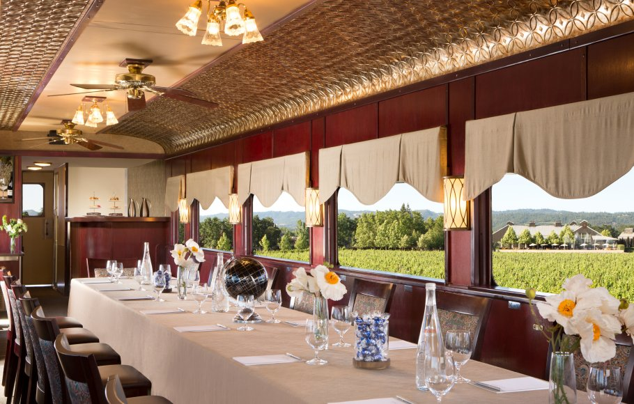 Long table with chairs and place settings for Railcar Boardroom setup on Napa Valley Wine Train
