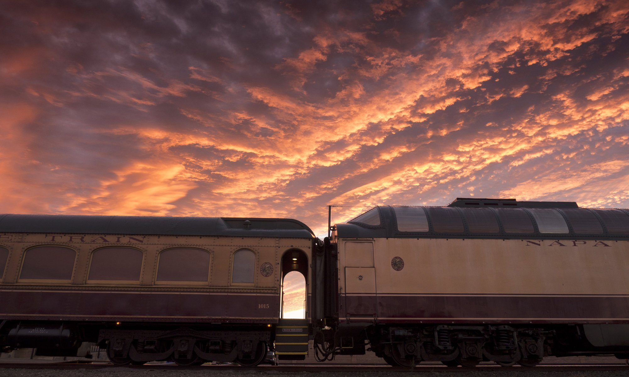 A train with the sunset in the background