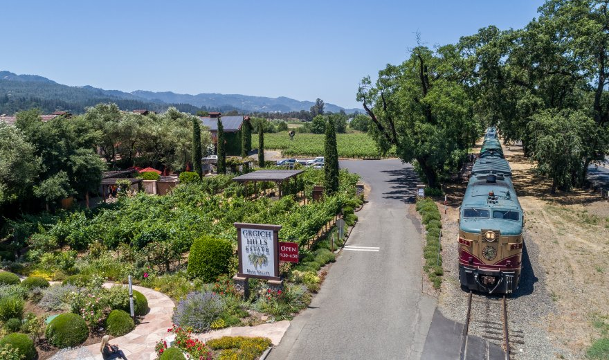 Napa Valley Wine Train stopped outside Grgich Hills Estate in Napa Valley on a sunny day