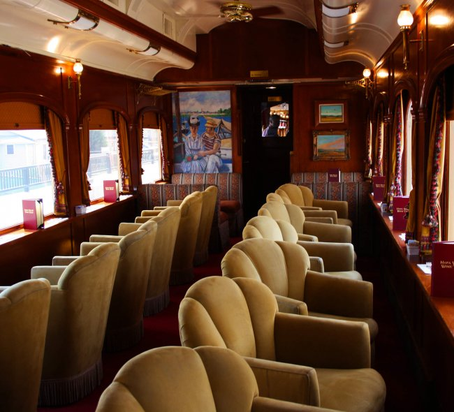 merlot lounge Napa Valley Wine Train train car with yellow velvet seating and dark wood
