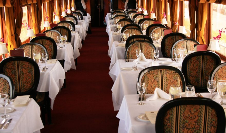 gourmet express train car on Napa Valley Wine Train with tables set for dinner with wine glasses