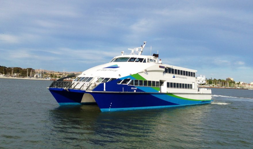 blue green and white ferry in San Francisco Bay