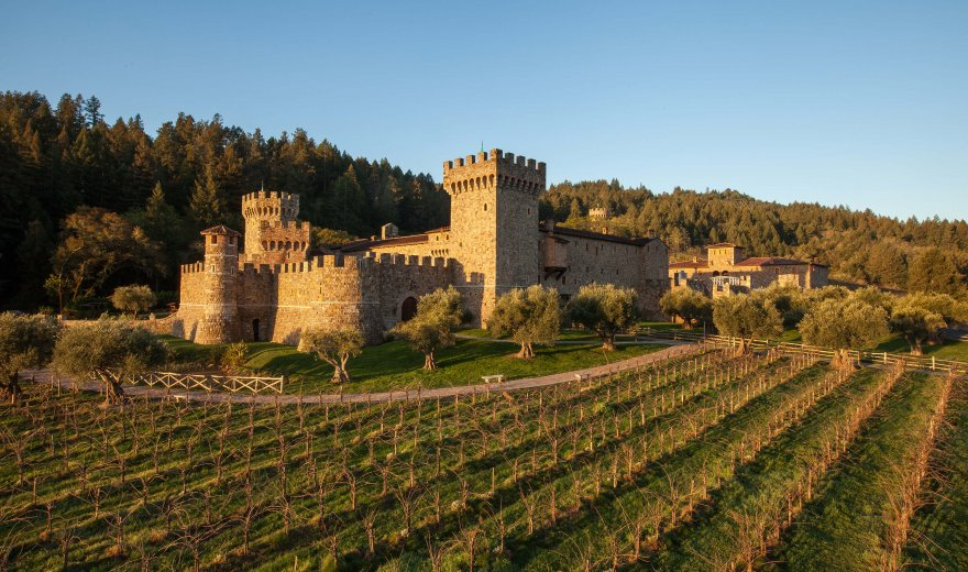 large stone castle surrounded by Napa Valley vineyards