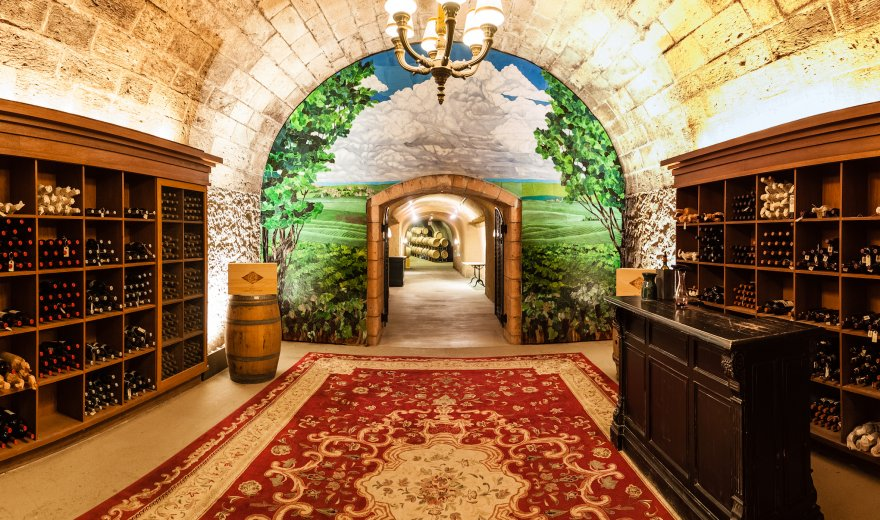 interior of Napa Valley winery with shelves of wine bottles