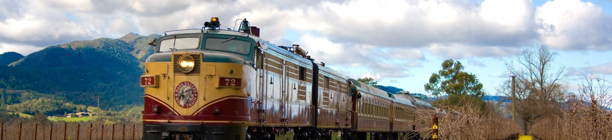The Napa Valley Wine Train runs alongside a California vineyard.