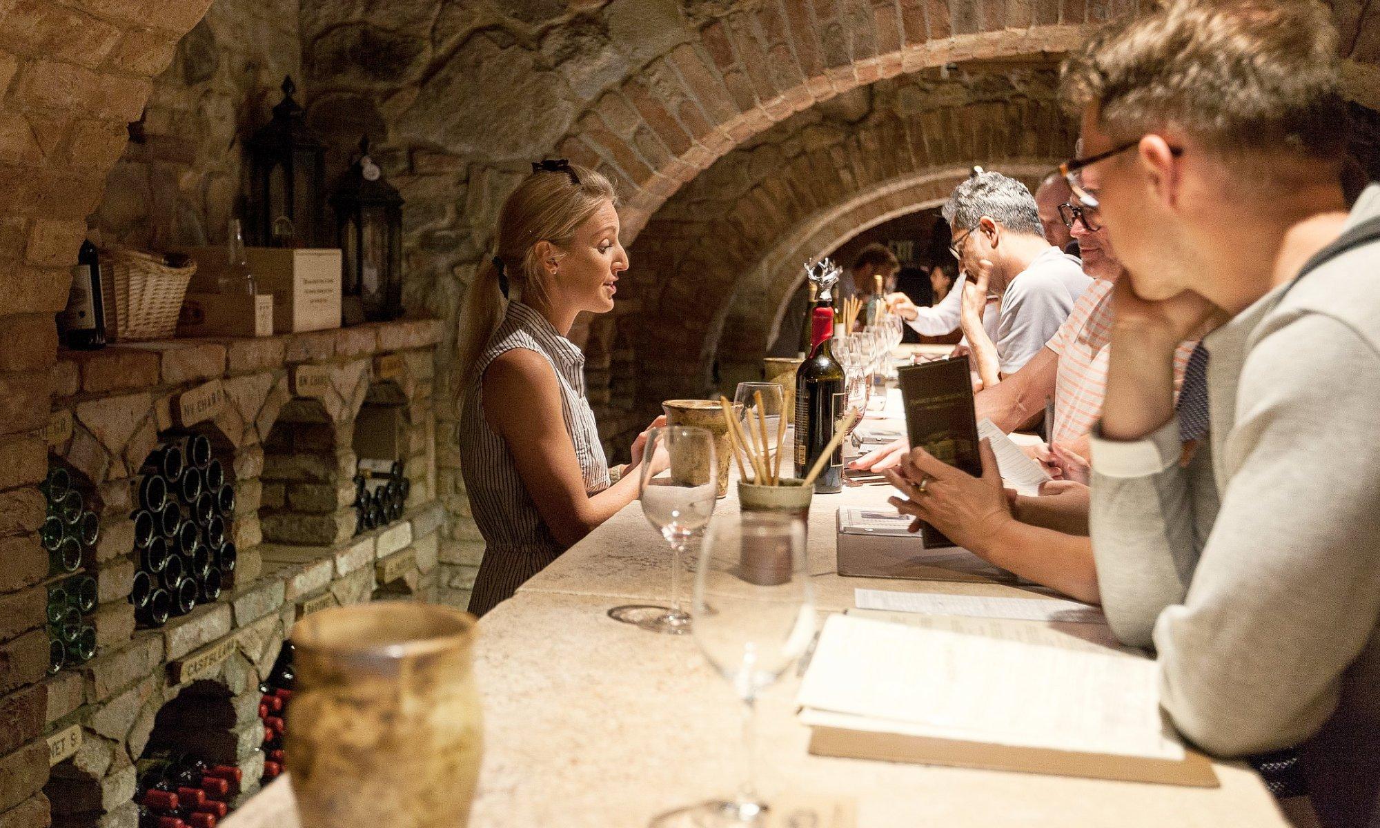 Bartender serving visitors at Castle Wine cellar tasting room