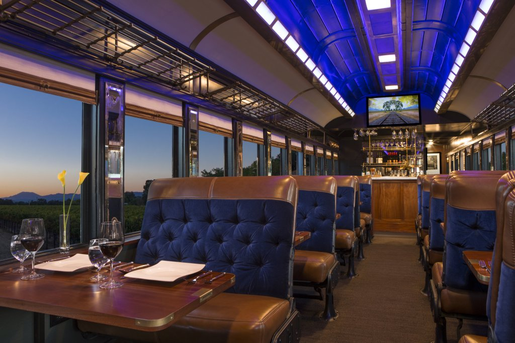 Lush interior of a furnished vintage railcar.
