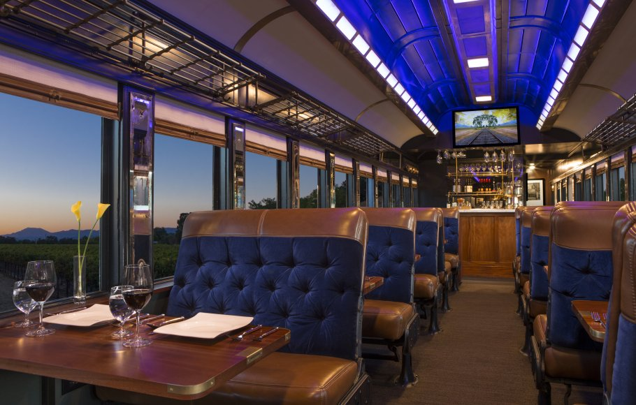 Blue velvet and brown leather interior of a vintage railcar on Napa Valley Wine Train