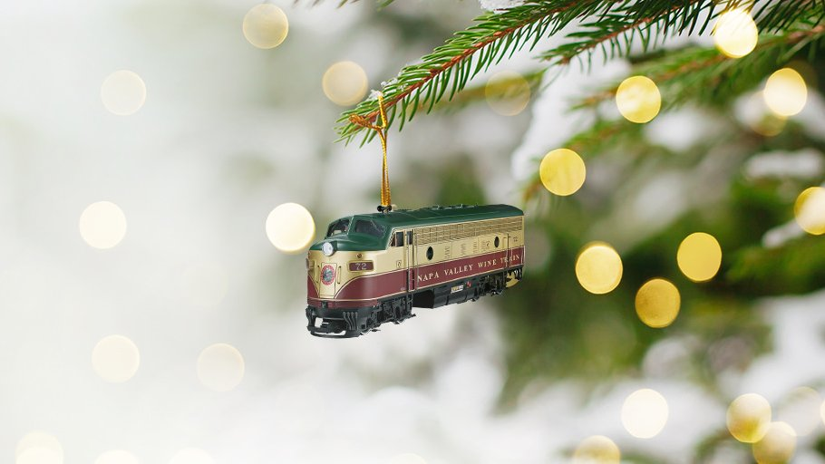 Wine train holiday ornament on a tree.