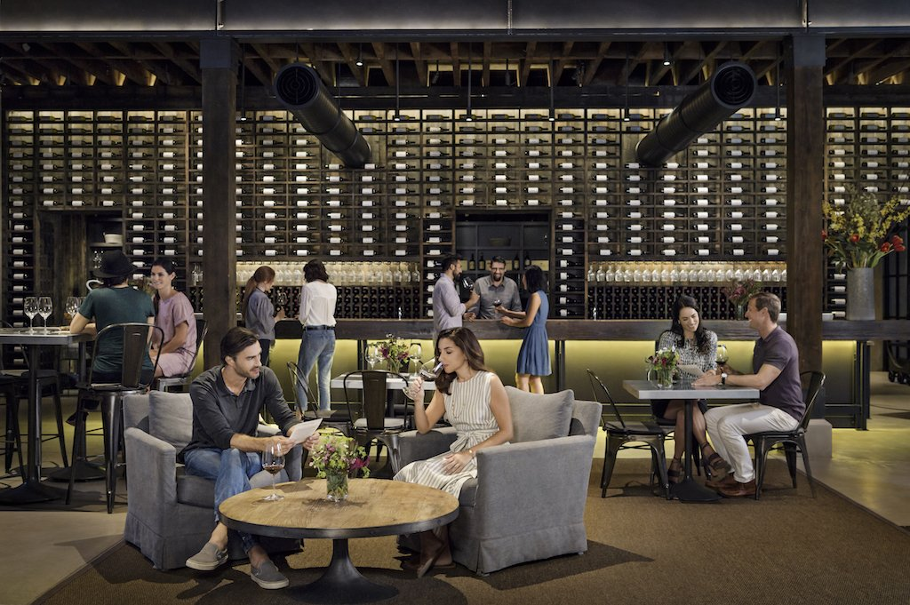 Couples relax and taste wine in a tasting room in Napa.