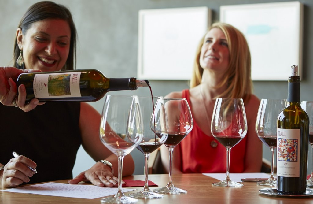 Two women enjoy a wine tasting in Napa.