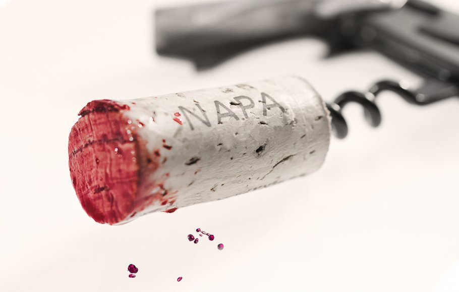 A black and white wine cork with red wine tip.