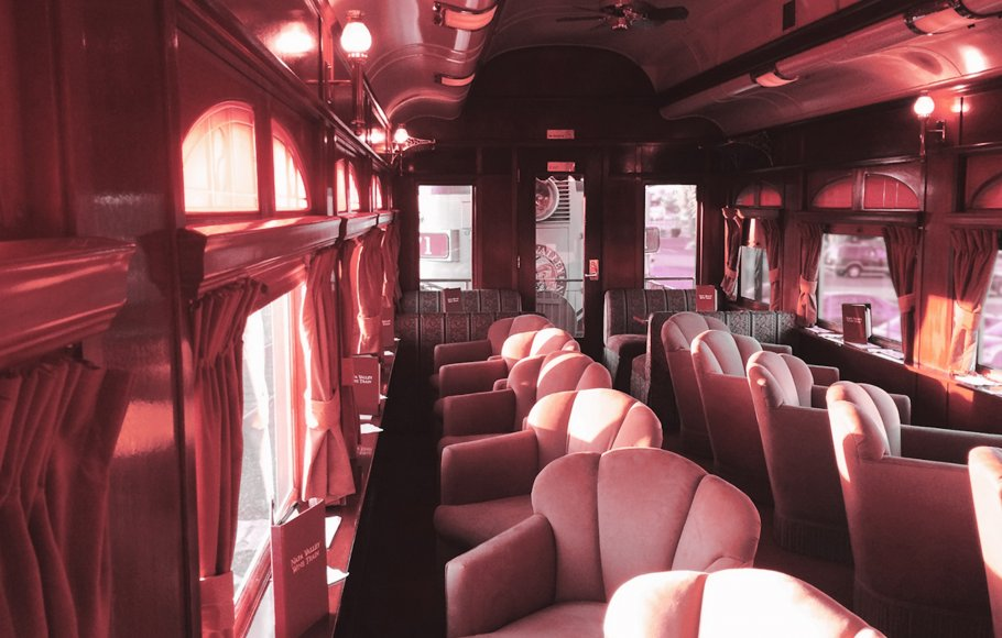 Beige velvet chairs lining right and left side of cart on Napa Valley Wine Train