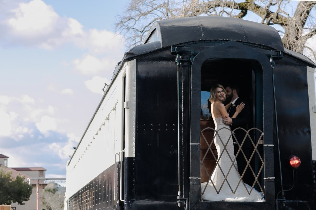 A bride and groom on the caboose care of the Napa Valley Wine Train