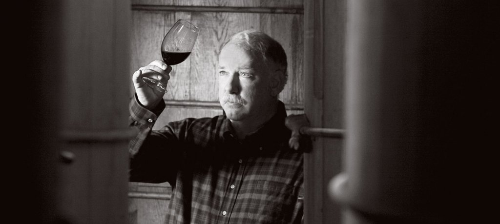 A winemaker inspects a glass of Cabernet Sauvignon.