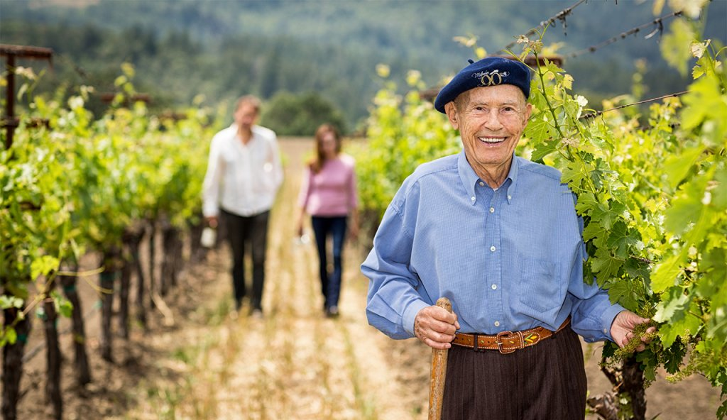 Mike Grgich and his family stand in a vineyard in Napa.