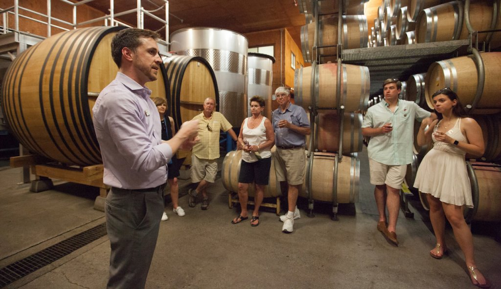 A winemaker leads a tour group through the Grgich Hills Estate wine cellar.